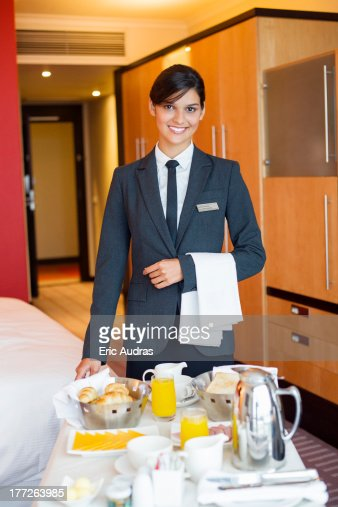 Portrait Of Waitress Smiling With Room Service Table In A Hotel ...