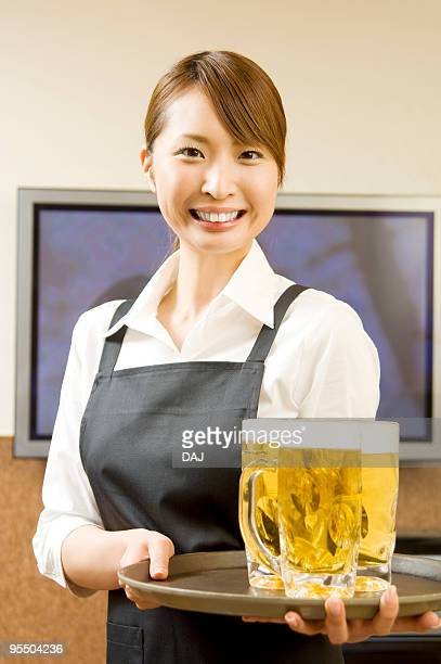 Portrait of waitress with beer