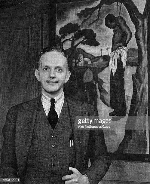 Portrait of Walter White, activist and Secretary of NAACP, in front of a painting depicting the lynching of an African American man, 1930.