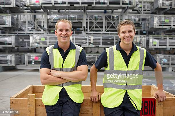 Portrait of warehouse workers in engineering warehouse