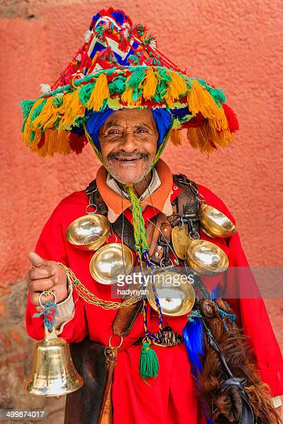 portrait of water seller in marrakesh, morocco - djemma el fna square stock photos and pictures