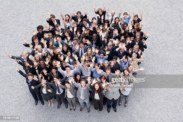 portrait of waving business people - large group of people stock pictures, royalty-free photos & images