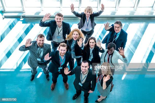 portrait of waving business people - press conference stock pictures, royalty-free photos & images