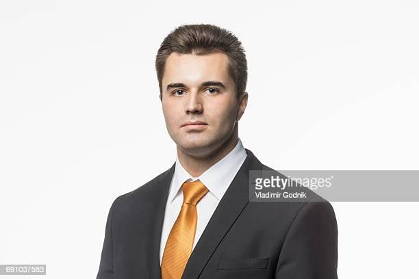 portrait of well-dressed businessman against white background - ネクタイ ストックフォトと画像