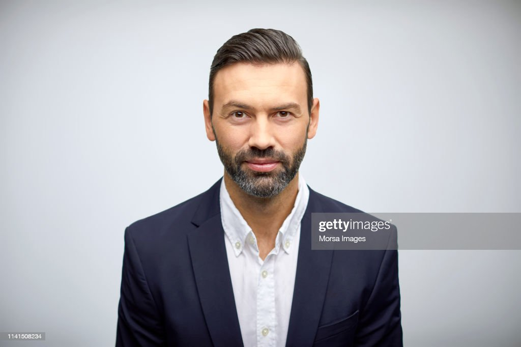 Portrait of well-dressed mature businessman : Stock Photo