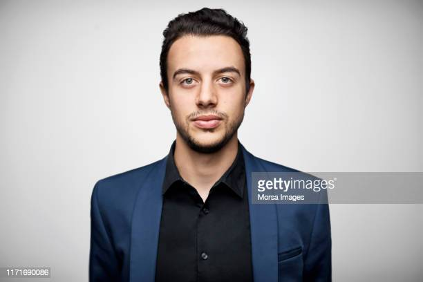 portrait of well-dressed young male entrepreneur - 20 24 years stock pictures, royalty-free photos & images