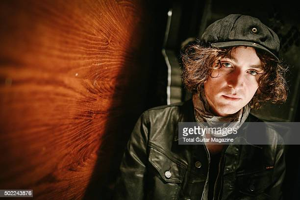 Portrait of Welsh musician Johnny Bond, guitarist with indie rock group Catfish And The Bottlemen, photographed before a live performance at the O2...