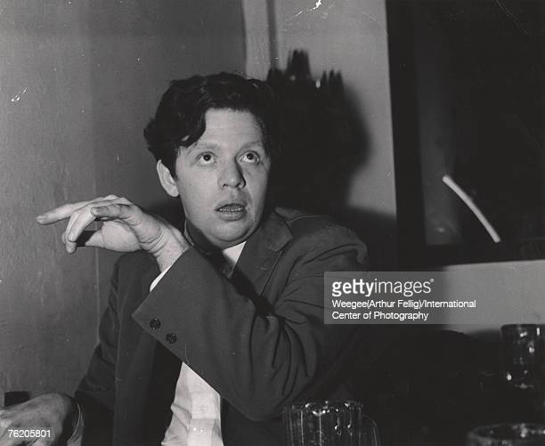 Portrait of Welsh poet Dylan Thomas as he sits in an unidntified bar early 1950s Photo by Weegee/International Center of Photography/Getty Images