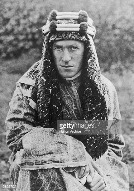Portrait of Welsh-born archaeologist, author and military leader Thomas E. Lawrence , aka 'Lawrence of Arabia', wearing a headdress. Lawrence led the...