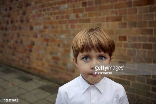 portrait of wide eyed schoolboy - staring stock pictures, royalty-free photos & images