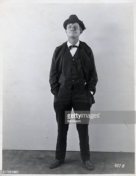 Portrait of Will Rogers American actor and humorist standing with hands in pockets Undated photograph