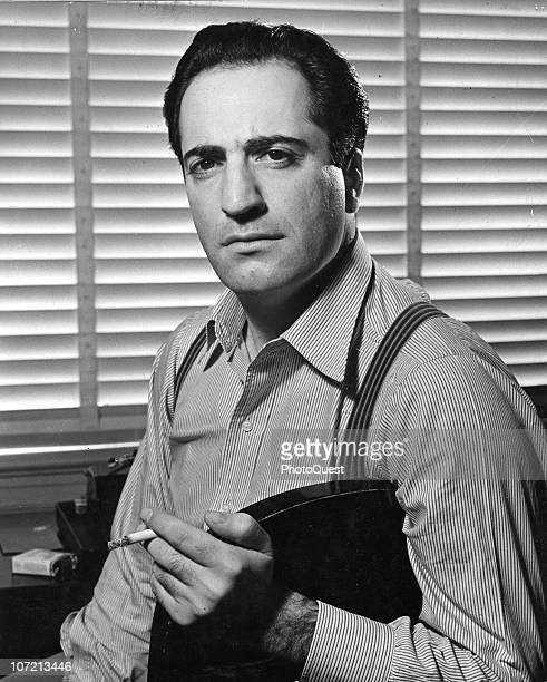 Portrait of William Saroyan , famous playwright of Armenian descent, whose talents have brought him widespread fame, holding a cigarette, 1940....