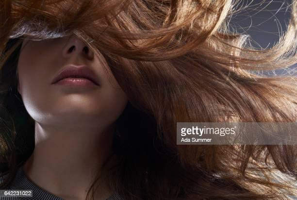 portrait of windblown brunette - haar stock-fotos und bilder