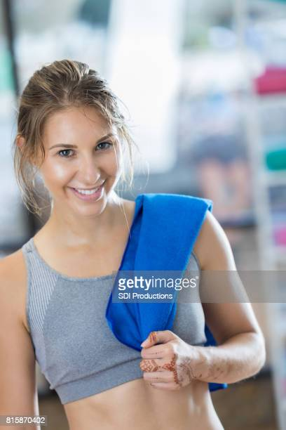 portrait of woman after exercise class - circuit training stock photos and pictures