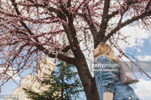 Portrait of woman against blossom tree