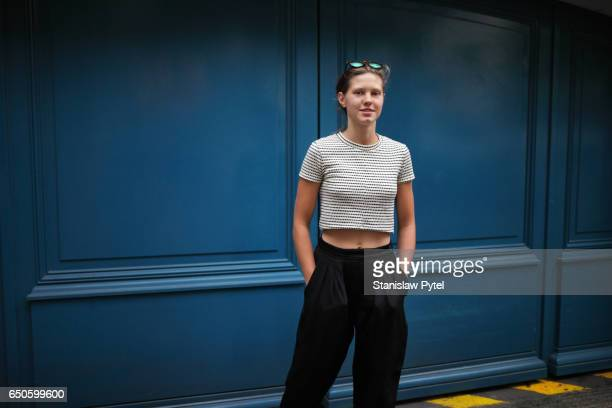 portrait of woman against blue wall - crop top stock pictures, royalty-free photos & images