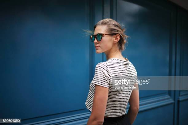 Portrait of woman against blue wall