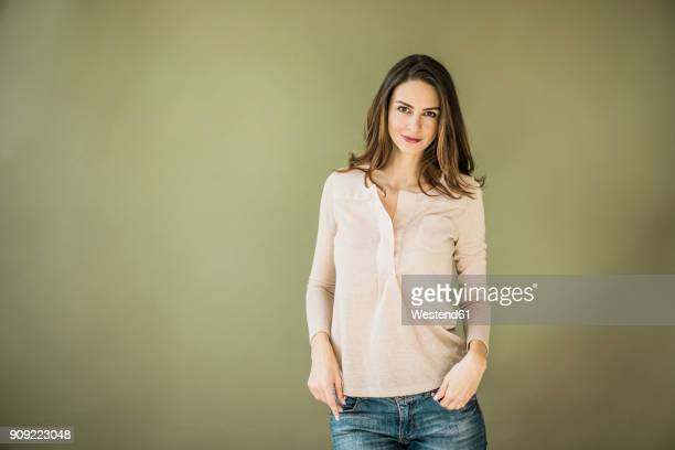 portrait of woman against green background - brown hair stock pictures, royalty-free photos & images