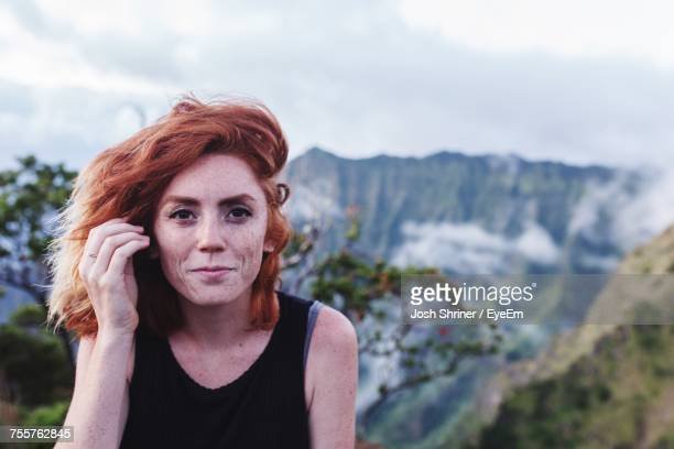 Portrait Of Woman Against Mountains