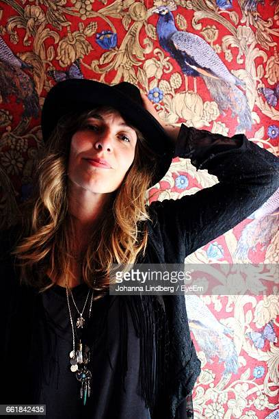Portrait Of Woman Against Wallpaper