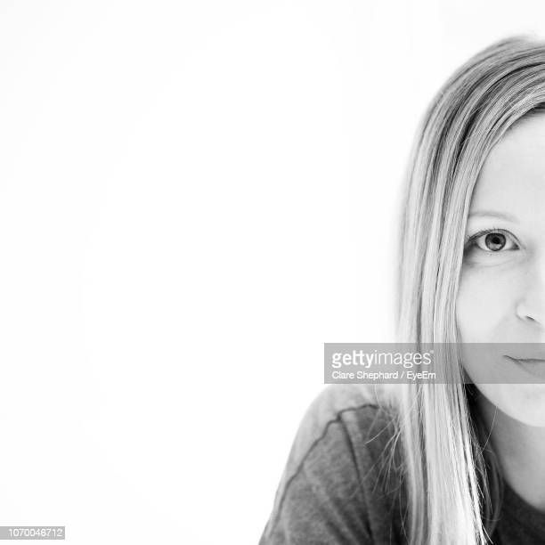 portrait of woman against white background - black and white stock pictures, royalty-free photos & images