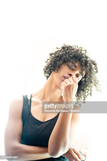 portrait of woman against white background - short hair stock pictures, royalty-free photos & images
