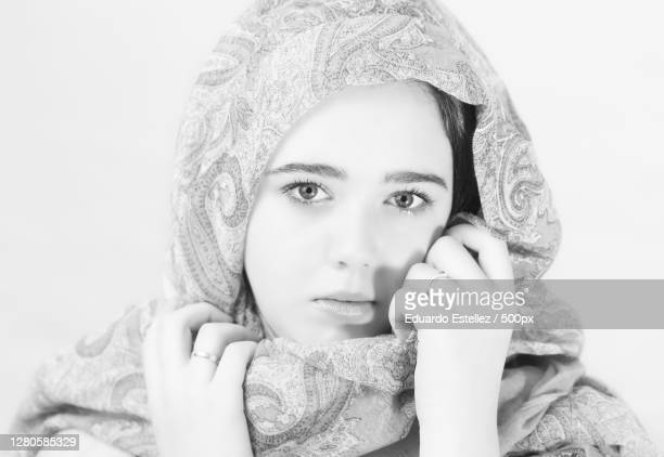 portrait of woman against white background,plasencia,extremadura,spain - blanco y negro stock pictures, royalty-free photos & images