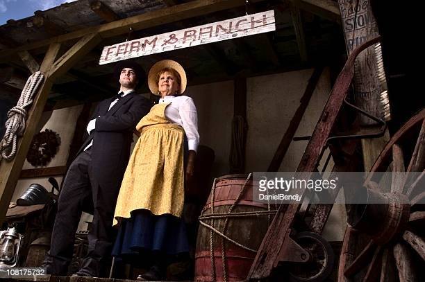 portrait of woman and butler at ranch - colonial america stock photos and pictures