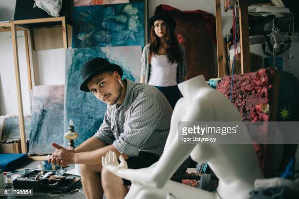 Portrait of woman and man  in art studio