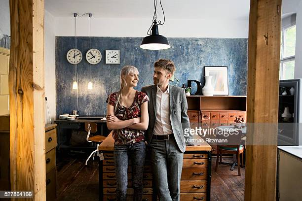 Portrait of woman and man in shop