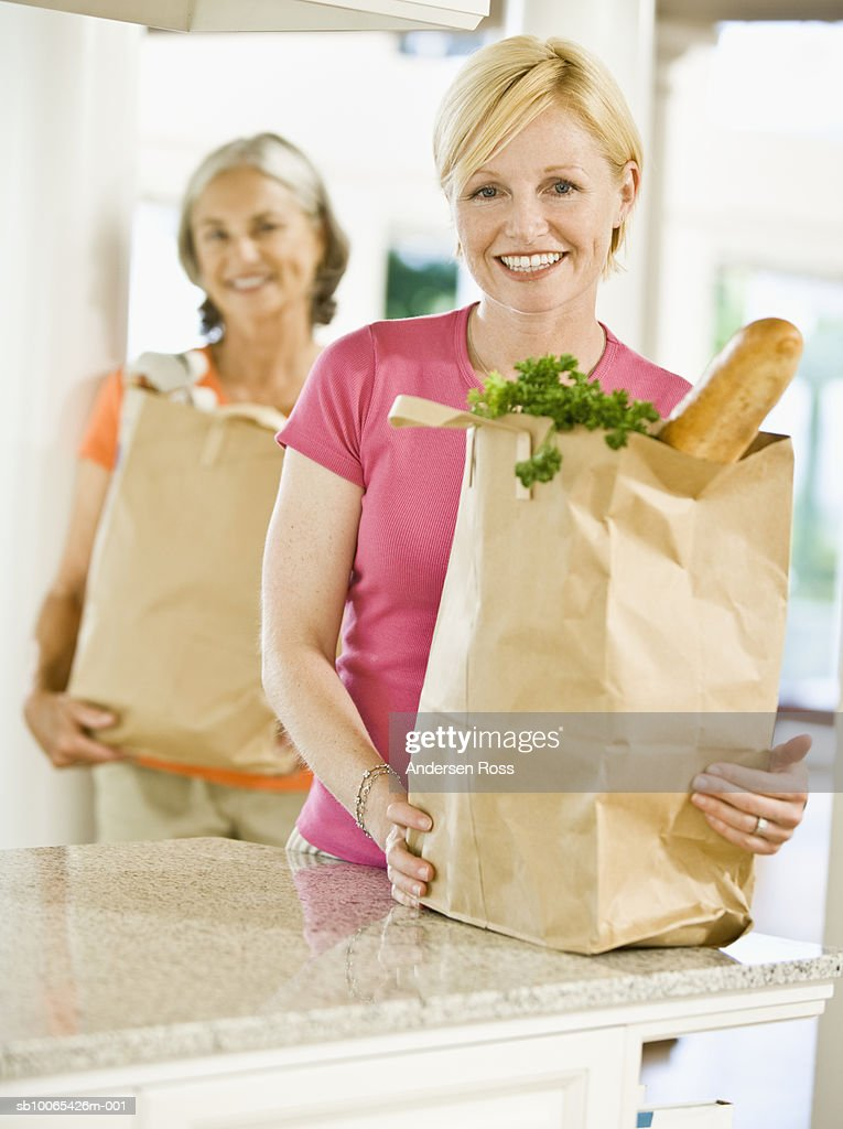 Portrait of Woman and Senior Woman with Groceries : Foto stock