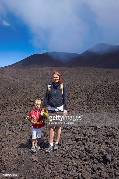 portrait of woman and son on mount etna, catania, sicily, italy - frank catania stock pictures, royalty-free photos & images