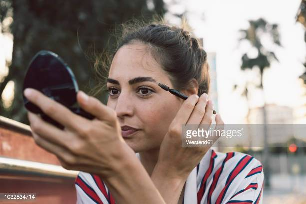 portrait of woman applying mascara - mascara stock pictures, royalty-free photos & images