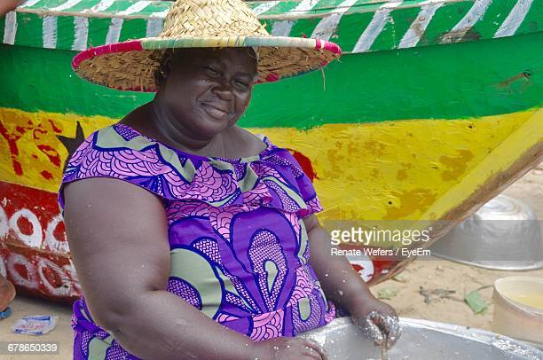 portrait of woman at beach against multi colored boat - images of fat black women stock photos and pictures