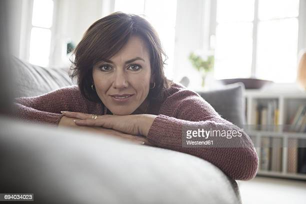 Portrait of woman at home lying on the sofa