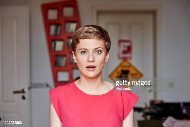 portrait of woman at home - one mid adult woman only stock pictures, royalty-free photos & images