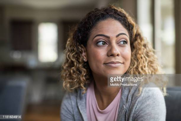 portrait of woman at home - puerto rican ethnicity stock pictures, royalty-free photos & images