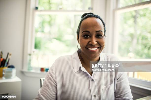 portrait of woman at home - looking at camera stock pictures, royalty-free photos & images