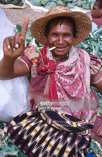 Portrait of woman at market place.