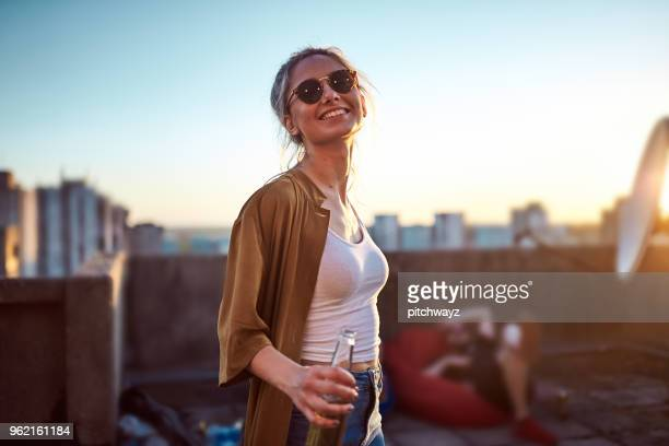 portrait of woman at roof party. - vita cittadina foto e immagini stock