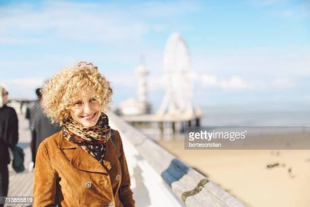 portrait of woman at seaside - bortes bildbanksfoton och bilder