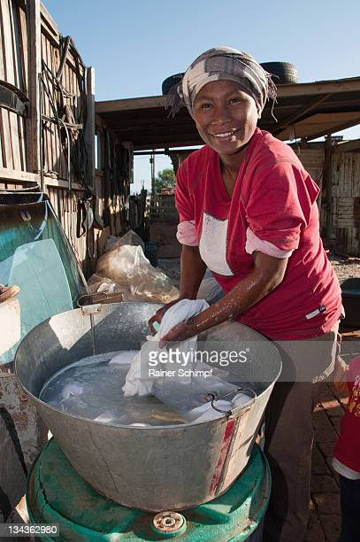 Portrait of woman at washing facility, Missionvale, Eastern Cape Province, Port Elizabeth, South Africa
