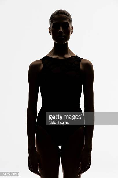 portrait of woman backlit looking at camera - back lit stock pictures, royalty-free photos & images