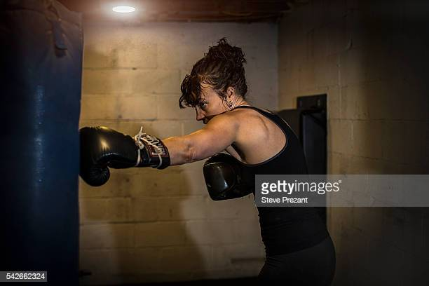 Portrait of woman boxer in home gym