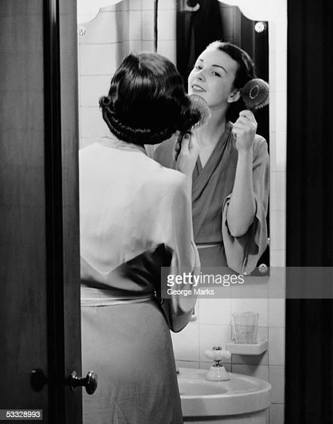 Portrait of woman brushing hair