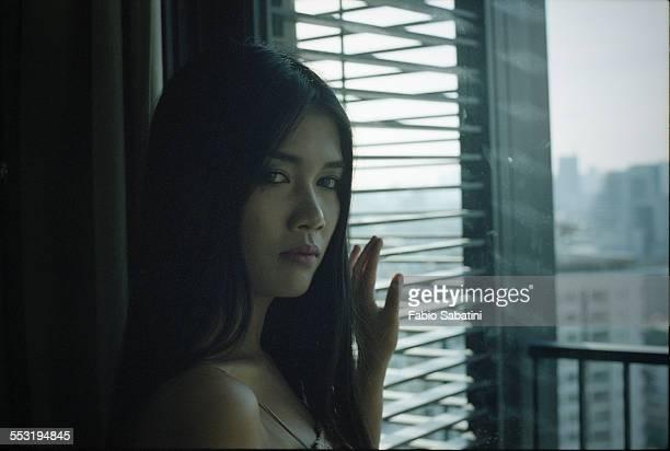 Portrait of woman by a window