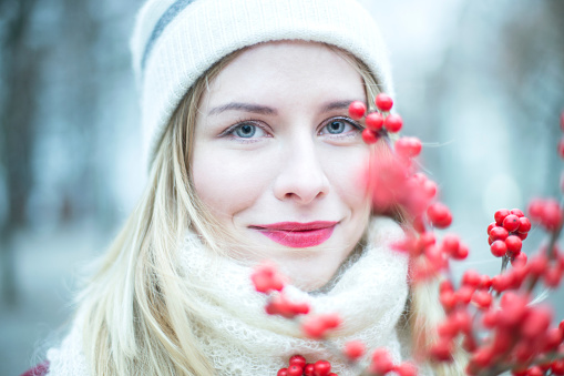 Portrait Of Woman By Red Fruits During Winter - gettyimageskorea