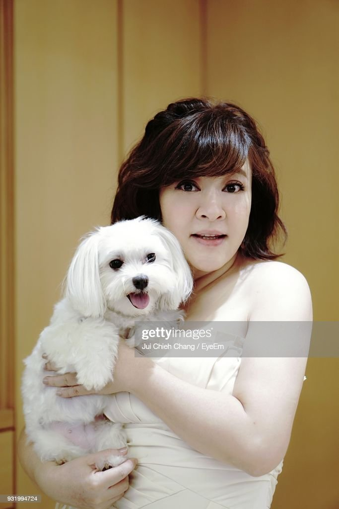 Portrait Of Woman Carrying Dog : Stock Photo