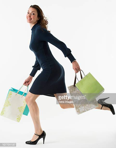 Portrait of woman carrying shopping bags