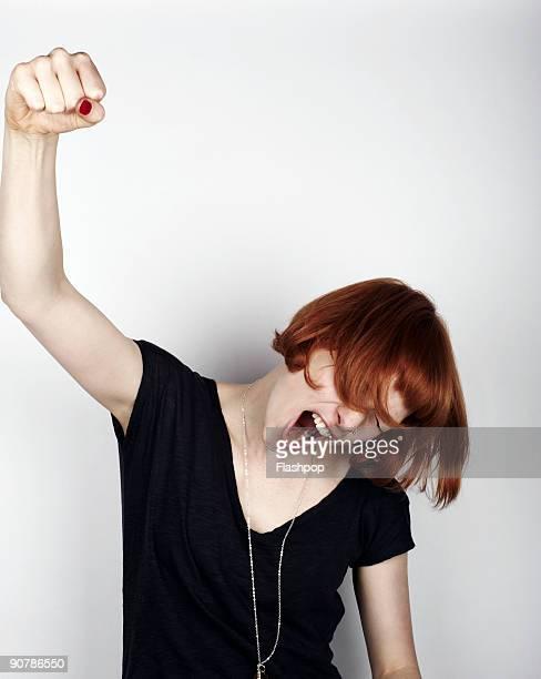 portrait of woman cheering - gestikulieren stock-fotos und bilder
